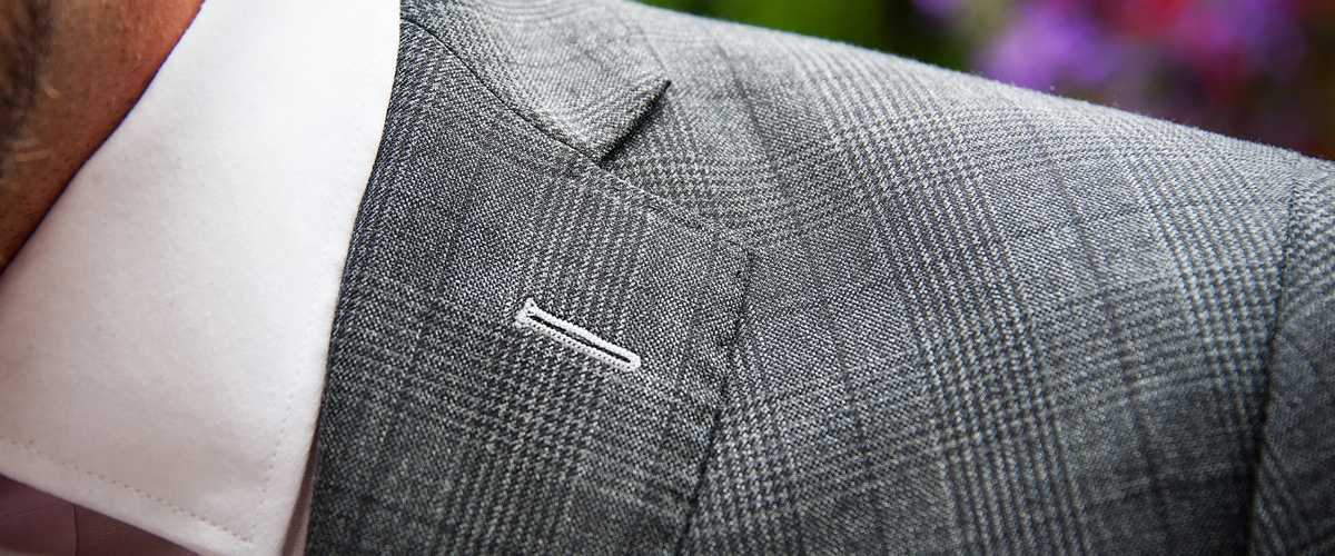 Tailored Prince of Wales grey check suit lapel detail